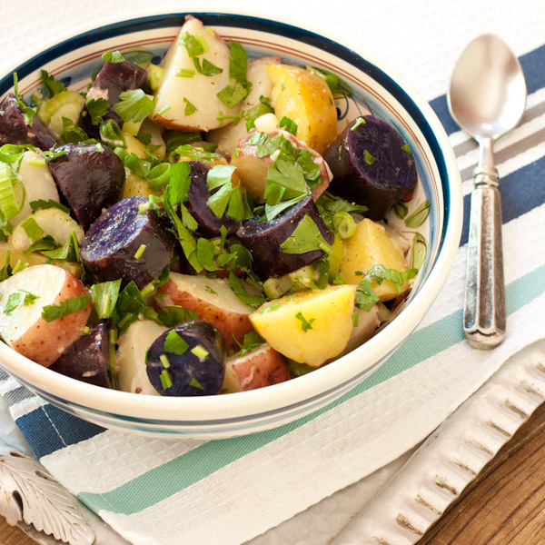 Red, white, and blue potato salad with peppery radish dressing from Recipe Renovator | Bright, fresh, herby as well as gluten-free, low-sodium, and dairy-free. Can easily be vegan.